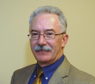 Dr. JOHN R. TRETTER
